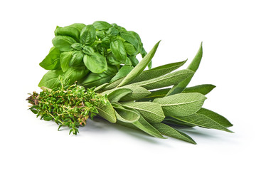 Bunch of sage, thyme and basil, isolated on white background.