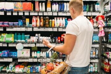 Male customer choosing personal hygiene products