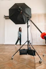 Model poses in photo studio, white background