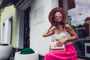 Young woman wearing stylish clothing with accessories outdoors. Beauty fashion concept