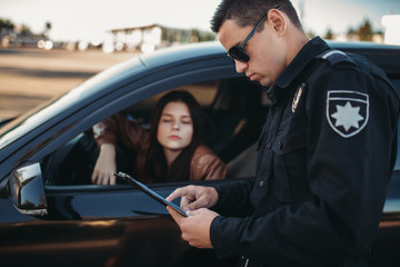 Cop in uniform checks license of female driver