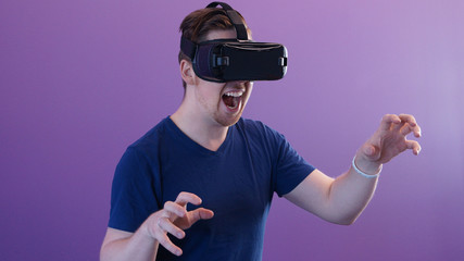 Man in front of purple background in VR
