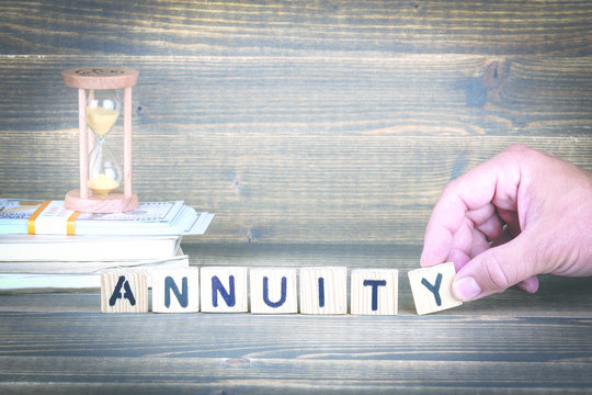 Annuity. Wooden letters on the office desk, informative and communication background