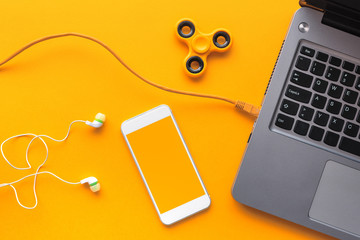 Gadgets belonging to young person, top view flat lay