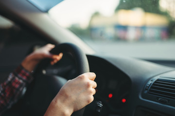 Fototapete - Female car driver beginner clung to the wheel