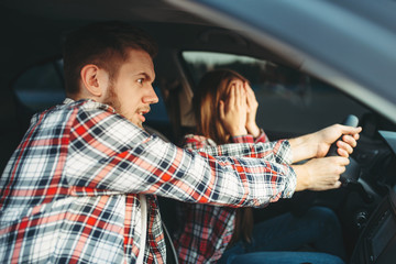 Fototapete - Driving Instructor helps driver to avoid accident