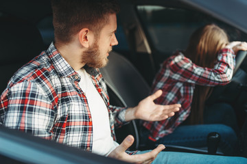 Fototapete - Driving instructor and sad female student