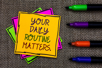 Text sign showing Your Daily Routine Matters. Conceptual photo Have good habits to live a healthy life Written on some colorful sticky note 4 pens laid in rank on jute base.