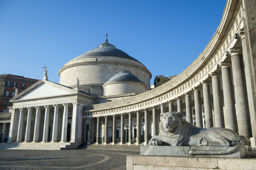 Scenic view of the San Francisco Basilica (built in 1816) dominated by the grand lionesses guarding the Piazza del Plebiscito in Naples, Italy