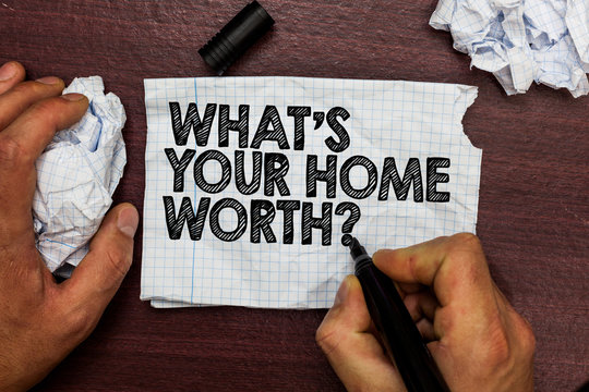 Conceptual hand writing showing What s is Your Home Worth question. Business photo text Value of a house Property Cost Price Rate Hand hold pen sketch word on torn page woody deck hand paper ball.