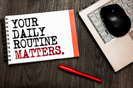 Conceptual hand writing showing Your Daily Routine Matters. Business photo showcasing Have good habits to live a healthy life Bluetooth mouse on keyboard words red pen on wooden deck.
