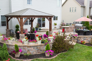 Colorful exterior curved patio with summer flowers