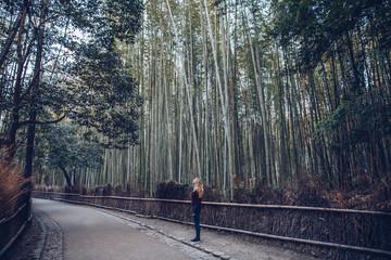 Woman walking alone in the Arashiyama Bamboo Forest