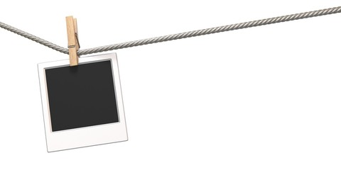 Clothes pin and blank photo paper hanging on rope 3D