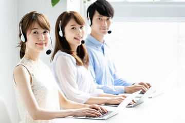asian operator working in office