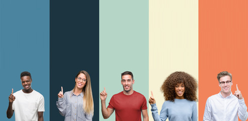 Group of people over vintage colors background showing and pointing up with finger number one while smiling confident and happy. Fototapete