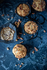 top view banana nut bread muffins with pecans on blue marble background