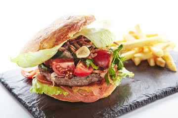 Fresh Beef Burger with Bacon, Fried Onions and French Fries Garnish