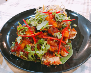 Deep fried grouper fish with sweet and sour chili sauce.