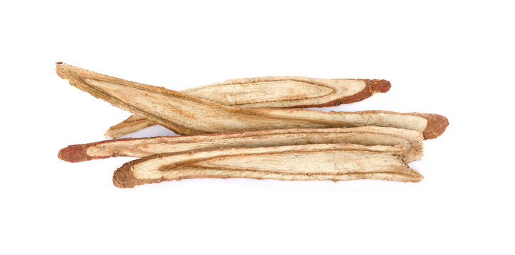 dried Liquorice roots on a white background.