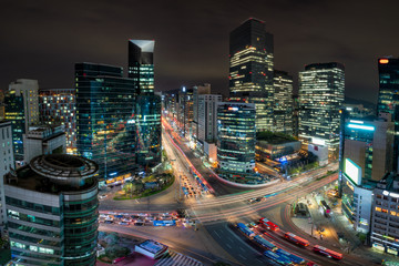 Wall Mural - Night scene of light trails traffic speeds through an intersection in Gangnam center business district of Seoul at Seoul city, South Korea.