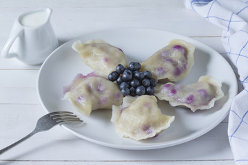 Vareniki (pierogi, dumplings) with blueberries