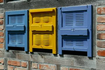 Traditional wooden blue and yellow bee boxes in Germany
