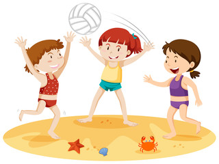 Three girls playing with a ball at the beach