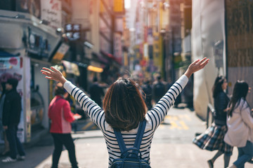 Fotobehang Seoel Young asian woman traveler traveling with happiness and shopping in Myeongdong street market at Seoul, South Korea. Myeong Dong district is the most popular shopping market at Seoul city.