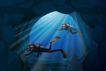 Diver diving in underwater cave