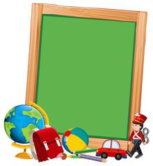 Blank blackboard with toys