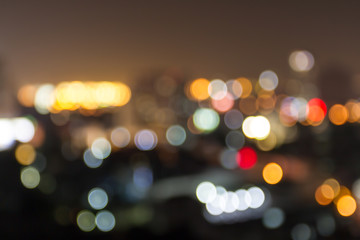 Defocus city light bokeh in the dark for abstract backdrop background texture