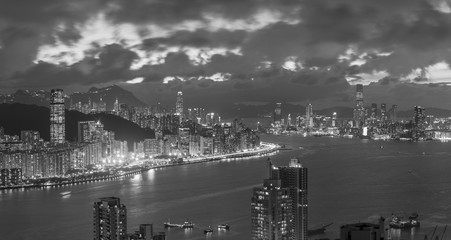 Fototapete - Panorama view of Victoria Harbor of Hong Kong city at dusk