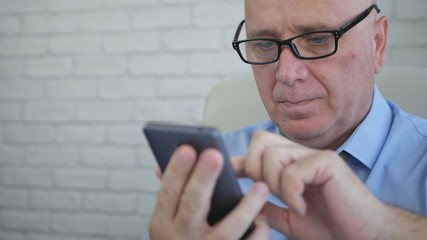 Businessman with Eyeglasses Text Using Mobile Phone