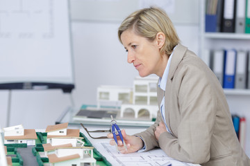 pensive experienced female architect at work in her office