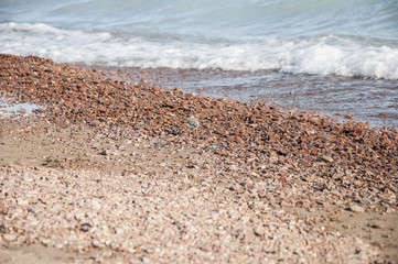 Beautiful sea waves hitting the pebble beach.