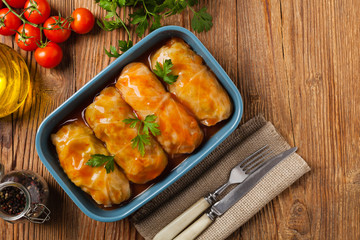 Traditional stuffed cabbage with minced meat and rice, served in a tomato sauce.