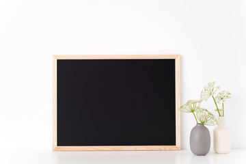 Chalk board mock up with a host in vases. Mockup for headline, design. Template for businesses, lifestyle bloggers,media