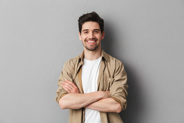 Portrait of a happy young casual man standing Wall mural