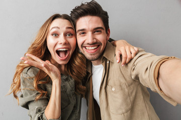 Portrait of an excited young couple hugging
