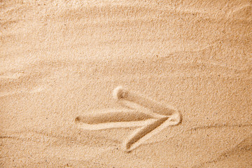 Arrow to the right of the sand