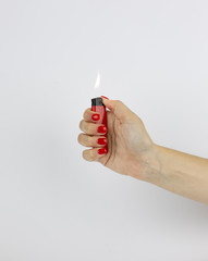 red lighter with fire in woman's hand isolated on white background