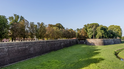 Beautiful panoramic view of the ancient walls of Lucca, Tuscany, Italy, in the late afternoon light