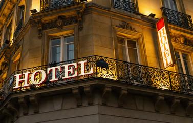 lluminated hotel sign taken in Paris at night