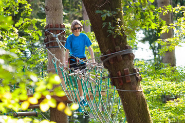 Teenager on rope way with zip line