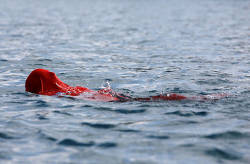 Bulgarian Yane Petkov, 64, wants to set a new Guinness World Record by attempting to swim more than three kilometers at Macedonia's Lake Ohrid  in a bag with his arms and legs tied up, in Ohrid