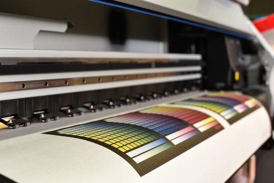 Wide format printer in work. Printing test image