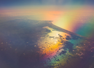 aerial panoramic landcapes over seacoast with milticolor reflection