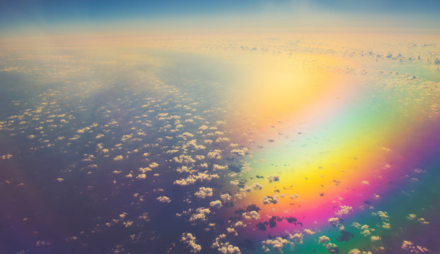 aerial panoramic cloudscape over sea in colorful reflection light