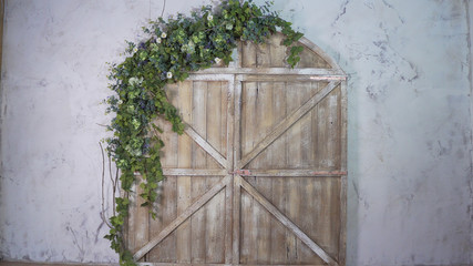 Beautiful photo zone: wooden gate and arch of flowers